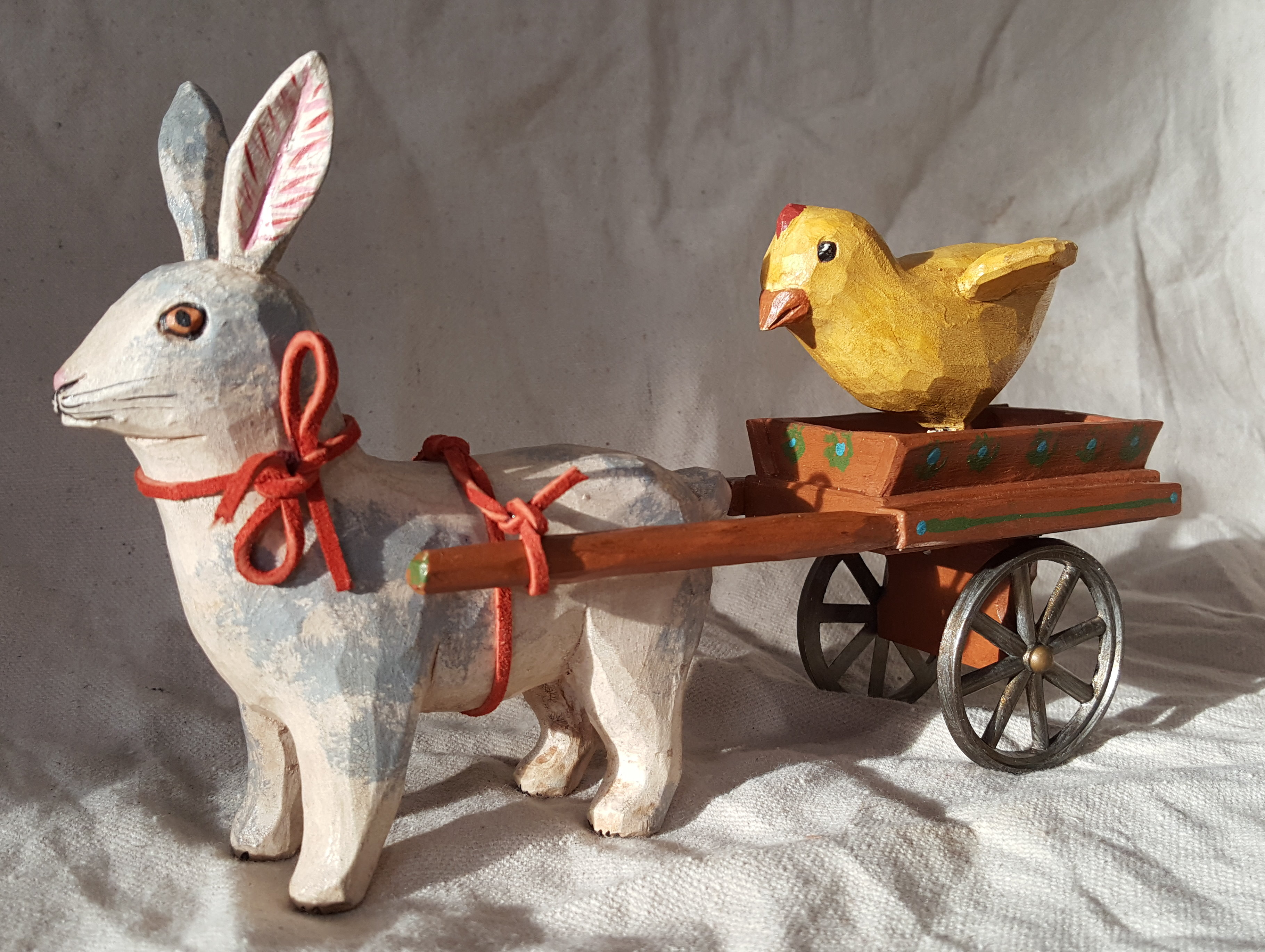Rabbit pulling Cart with Chick